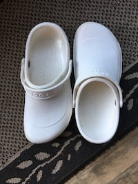 pair of white Crocs clogs Beaconsfield, H9W 2L3