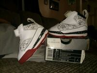 pair of white-and-red Nike sneakers