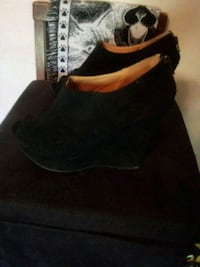 pair of women's black suede wedges Houma