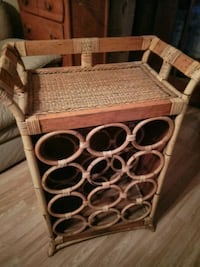 Have a like new wood wine rack holds 12 bottles re 709 mi