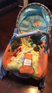 baby's yellow and blue bouncer Laval, H7W 0B5