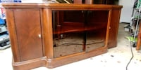 brown wooden framed glass top TV stand Washington, 20015