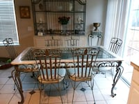 rectangular glass-top table with four chairs 386 mi