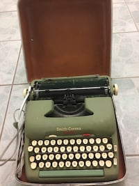 black and brown typewriter with case Toronto, M6E 3X1