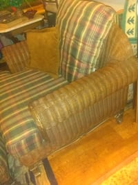 Heavy wicker and iron chair and ottoman 183 mi
