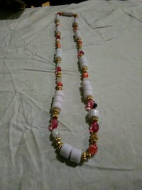 red and brown beaded necklace New York, 10035