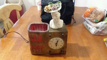 Antique lady head clock