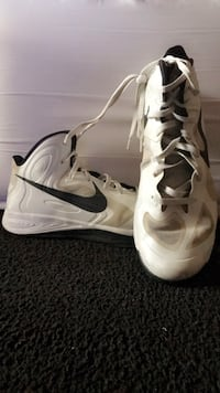 Pair of white and silver nike sport shoes Evansville, 47720