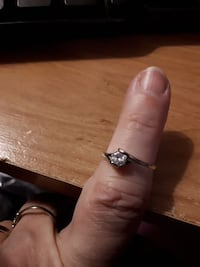 White gold plated with cz stone. Size 6.5