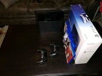 black Sony PS4 console with controller and game cases Denver, 80219