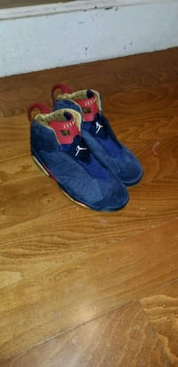 pair of blue-and-red Nike basketball shoes Philadelphia, 19140