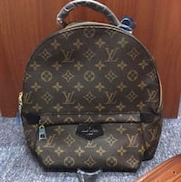 brown monogrammed Louis Vuitton leather backpack
