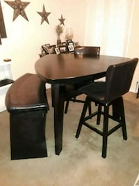High-top table, bench, and two swivel chairs Tampa, 33604