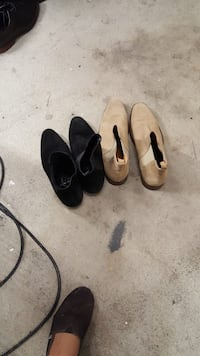 Two pairs of black and brown leather sandals Richmond, V6X 2R5