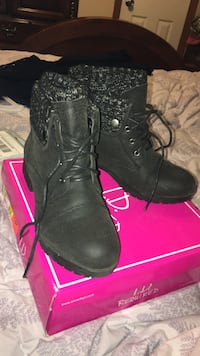 pair of black I.D. Required leather chunky-heeled boots with pink box