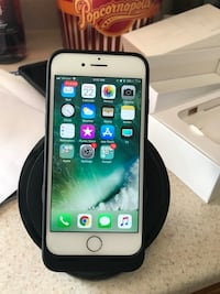 Unlocked iPhone 7. Includes mophie case and wireless charger Brick, 08723