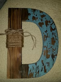 brown and blue D wooden wall decor
