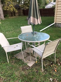 Glass patio table with chairs and umbrella Lansing, 48910
