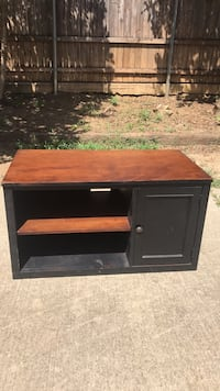 brown and black wooden TV stand Highland Village, 75077