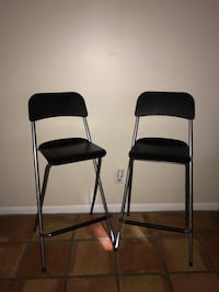 two black foldable stools