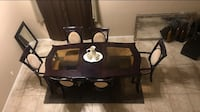 Dining table with 4 chairs and 2 king chairs also comes with one leaf very good condition but must pick up. No delivery. It's cherry wood color.  Phoenix, 85041