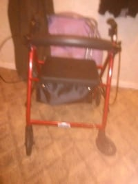 red and black adult sit down walker Newport, 37821