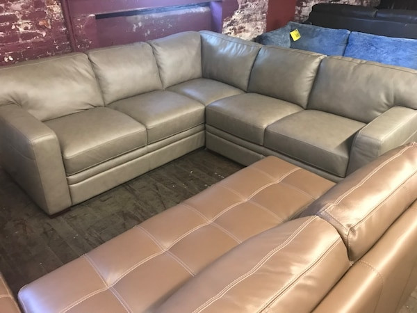Gray leather sectional sofa with ottoman