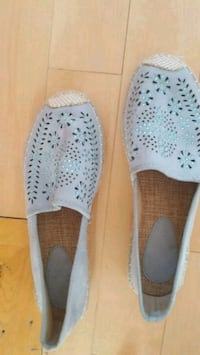 pair of white slip on shoes Laval, H7V 3A7