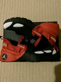 pair of red-and-black Nike basketball shoes Mississauga