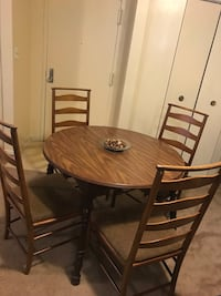 5 pieces dining set wood table with 4 new upholstered cushion check out my other listings on this page message me if you interested pick up in Gaithersburg md 20877 Gaithersburg, 20877