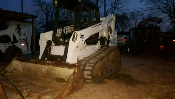 white and gray front loader