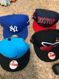 four black, blue, and red fitted caps Manassas, 20110
