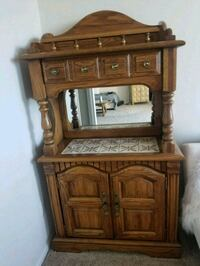 brown wooden cabinet with mirror Alexandria, 22304