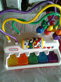 white Little Tikes wire maze and piano toy set