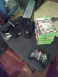 black Xbox 360 console with controller and game ca Ocala, 34474
