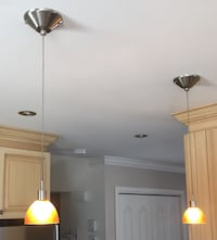 Two orange down light lamps with stainless steel base Notre-Dame-des-Prairies, J6E 1E6