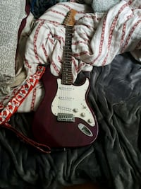 Red and white stratocaster electric guitar Calgary, T2E 0W3