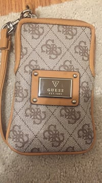 monogrammed gray and brown Guess leather wristlet