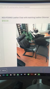 black leather padded rolling armchair Toronto, M5V 0J9
