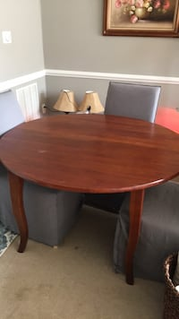 round brown wooden table with four chairs dining set Alexandria, 22309