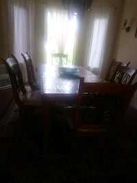 rectangular brown wooden table with six chairs din Whitby, L1P 1K9
