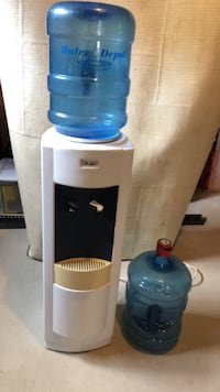 Water cooler and 2 bottles  Clarington, L0B 1J0