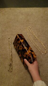 beige and black case; two gold-colored chain necklaces Manassas, 20109