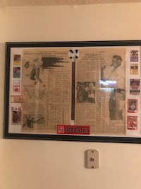 Framed newspaper articles 97, ticket stubs, Osborne and Rogers card 989 mi