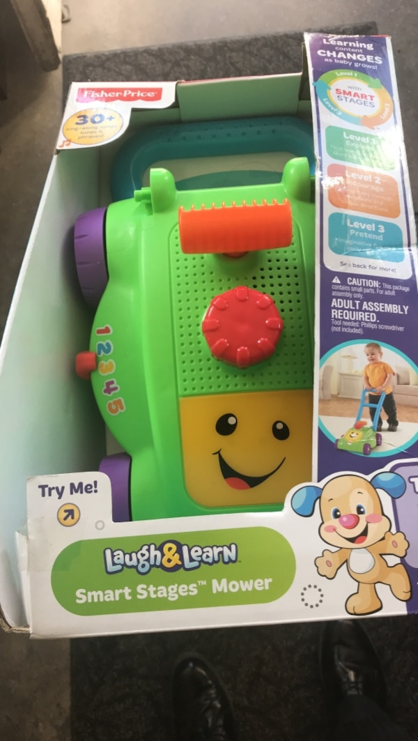 green and purple Fisher-Price Laugh & Learn Smart Stages Mower