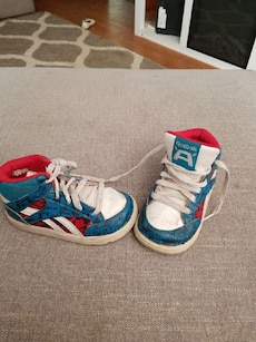 children's pair of blue, white and red reebok high tops
