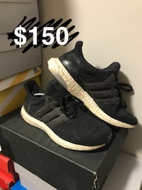 Pair of black adidas low-top sneakers with box 3119 km