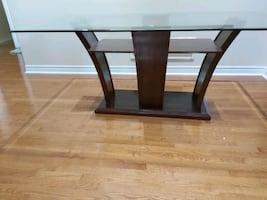Glass top dinning table brown.
