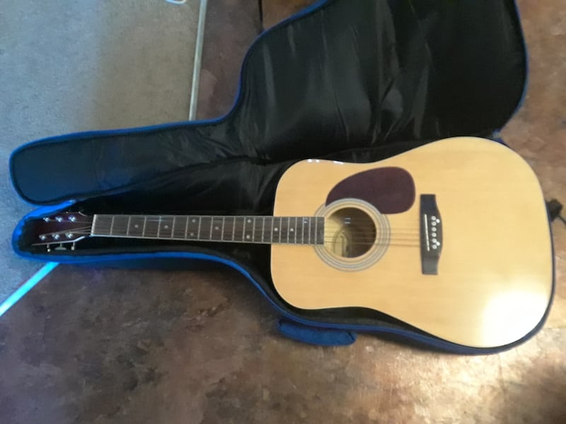 Brunswood Guitar and Case d35c0382-54f2-4229-99fa-0fd0b19302ee
