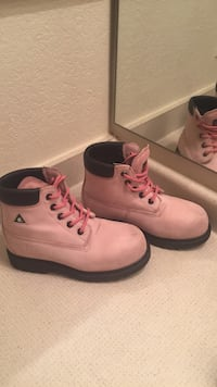 pair of pink Timberland work boots 19 mi